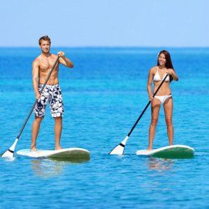 despedidas de soltero y soltera en verano en Gijón haciendo paddle surf